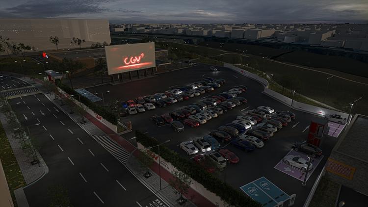 인천 연수구 스퀘어원 인근 부지에 새로 오픈할 CGV DRIVE IN 스퀘어원의 예상 모습을 그린 조감도로 커다란 스크린 앞에 자동차들이 모여 있는 모습